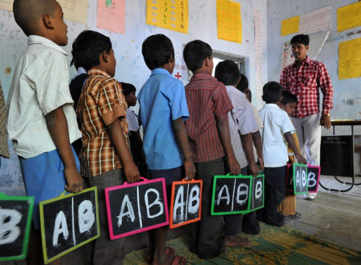 Indian schoolchildren stand in line with English alphabets written on their slates at a government primary school in the outskirts of Hyderabad on June 13, 2011, on the opening day of the new academic year. The government of India's Andhra Pradesh state has introduced English as a second language from Class 1 onwards for the 2011-2012 academic year. India's National Knowledge Commission has admitted that no more than one percent of country's population uses English as a second language. AFP PHOTO/Noah SEELAM