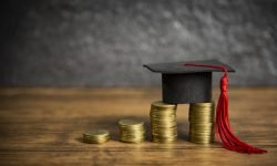 Scholarships education concept with graduation cap on coin money